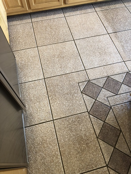 Tile and grout after portion of it has been cleaned