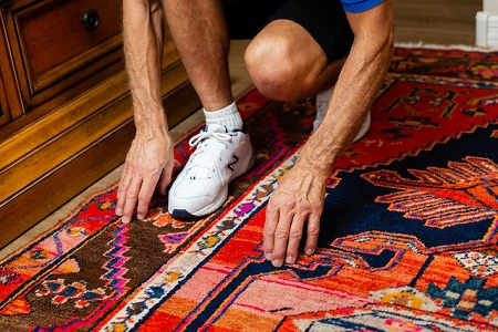 Technician inspecting fine area rug prior to cleaning