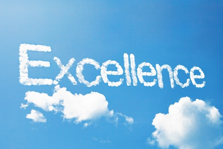 """The word """"Excellence"""" written in the sky with white smoke"""